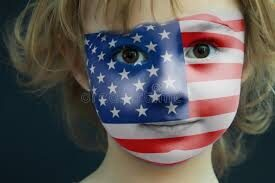 Child face painted with American flag