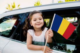 Child with Romanian flag